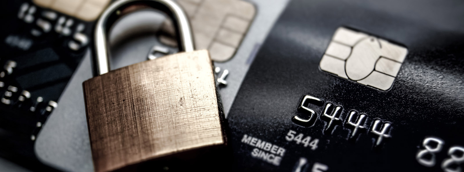 padlock lying on an array of debit/credit cards