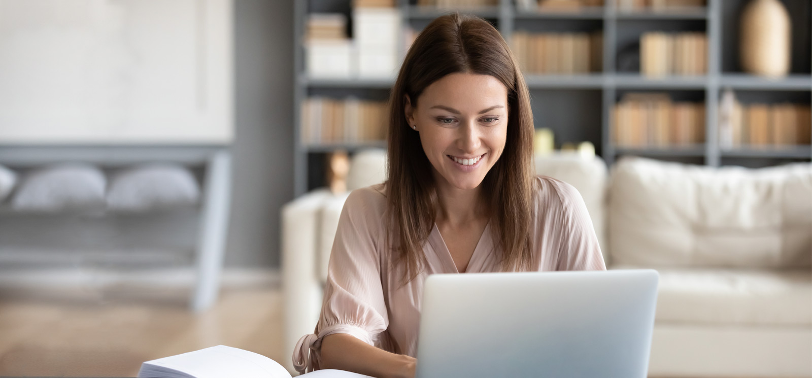 smiling woman using laptop